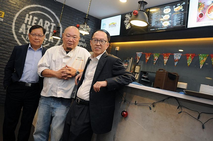 (From left) Western food chain Eighteen Chefs co-founders Roger Wong, 58, and Benny Se Teo, 55, with newly appointed group CEO Davy Wee, 58, who formerly headed POSB and The Manhattan Fish Market restaurant chain.