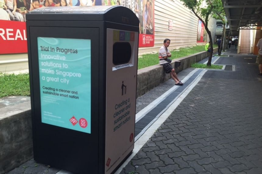 A smart bin at Hong Kah North Community Club, which has sensors that alert the town council when it is full.
