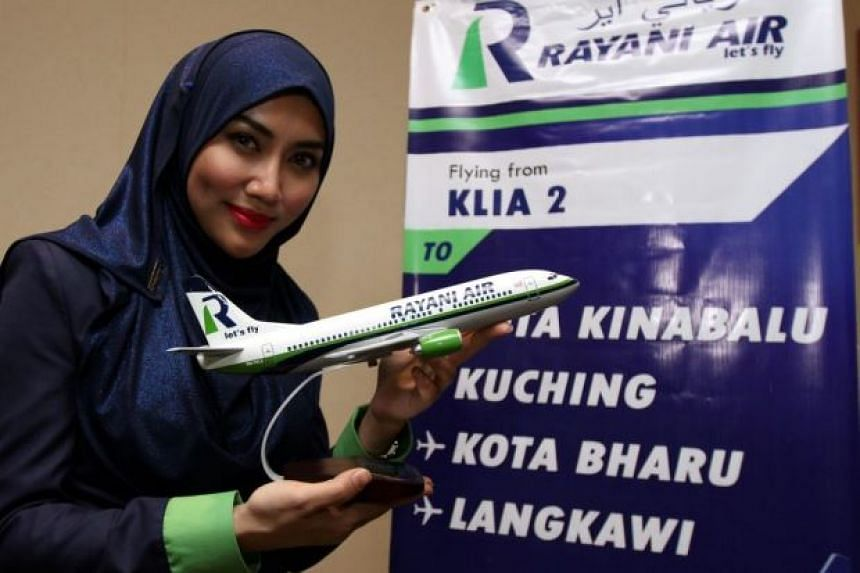 The full-service Rayani Air's Muslim crew are required to wear the hijab, or headscarf.