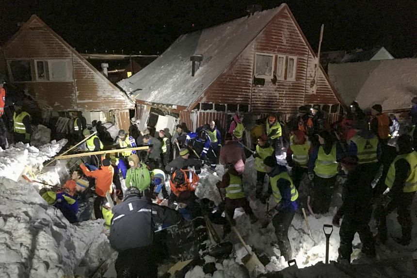 Search crew work in an area hit by the avalanche in Longyearbyen.