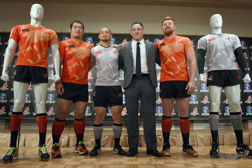 Newly appointed Sunwolves coach Mark Hammett (second right) posing with players (from left) Shinnosuke Kakinaga, Yuki Yatomo and Edward Quirk, in Tokyo on Dec 21, 2015.