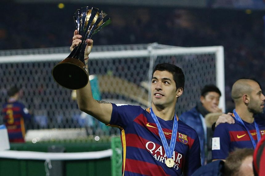 Luis Suarez celebrates winning the Fifa Club World Cup Final.