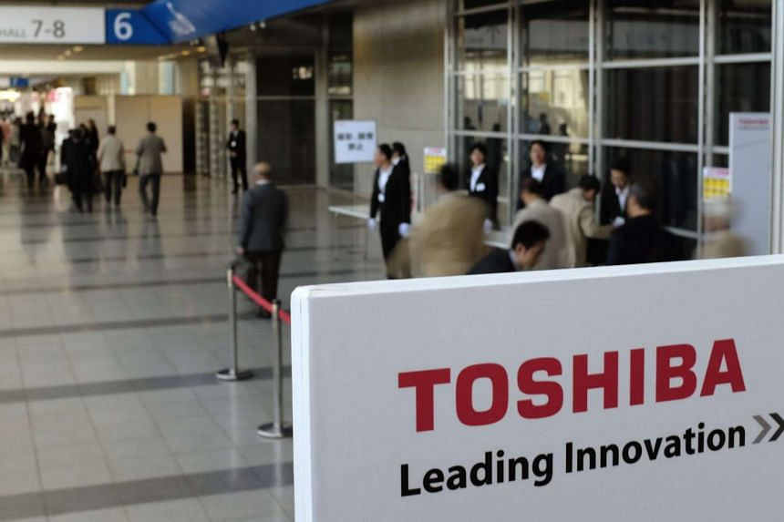 Shares of Toshiba Corp slumped the most in seven months after reports it would post a record 500 billion yen (S$5.82 billion) loss in the current fiscal year on costs related to an accounting scandal, layoffs and sales of business units.