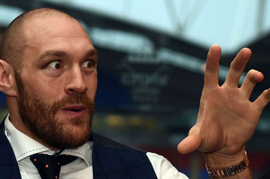 Britain's world heavyweight champion Tyson Fury speaks during a press conference in Bolton.