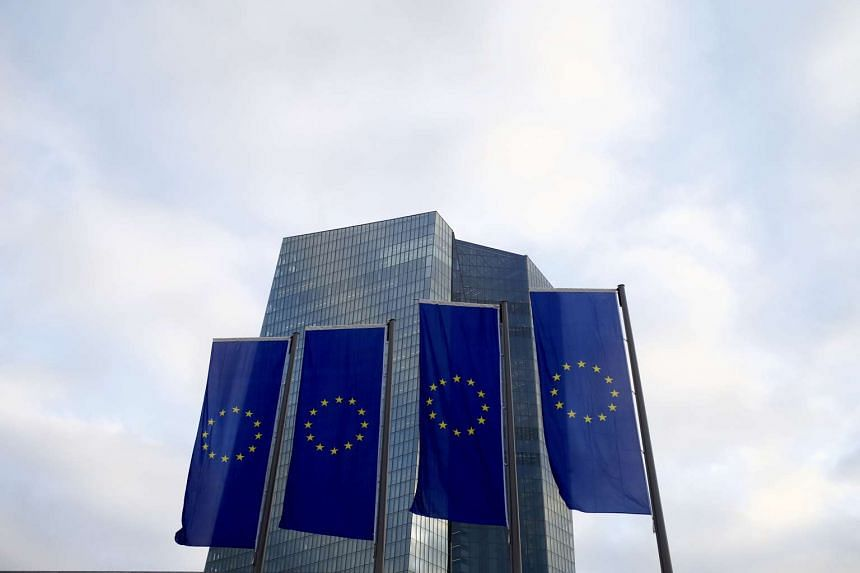 European Union flags fly in front of the European Central Bank headquarters.