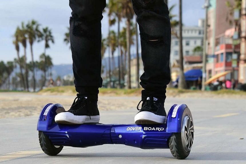 A user on his hoverboard on the Venice Beach boardwalk.