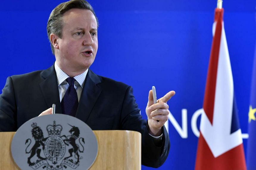 Britain's Prime Minister David Cameron gestures during a news conference after a European Union leaders summit in Brussels.