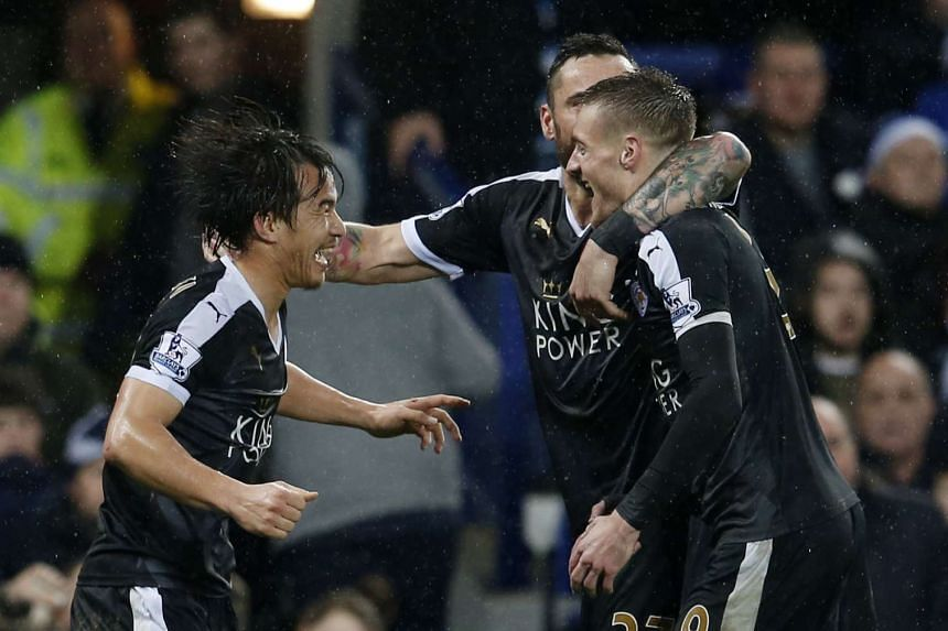 Leicester City's Shinji Okazaki (left) celebrating with Jamie Vardy (right) and Marcin Wasilewski during their EPL match against Everton at Goodison Park on Dec 19, 2015.