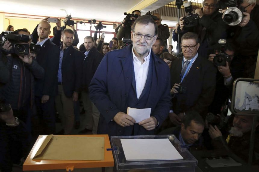 Spanish Prime Minister Mariano Rajoy, casts his vote at a polling station in Madrid, Spain, during the Spanish general elections on Dec 20, 2015. His conservative People's Party is facing off against the Socialist Workers' Party, the liberal Ciudadan