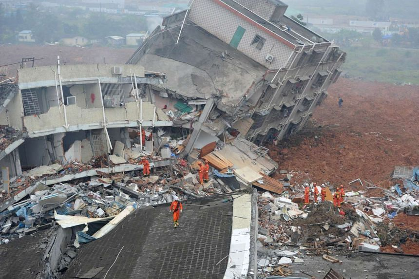 Rescuers looking for survivors after a landslide hit an industrial park in Shenzhen in south China's Guangdong province on Dec 20, 2015.