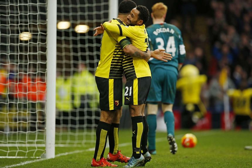 Watford's Troy Deeney and Ikechi Anya celebrate after Odion Ighalo scores their third goal on Dec 20, 2015.