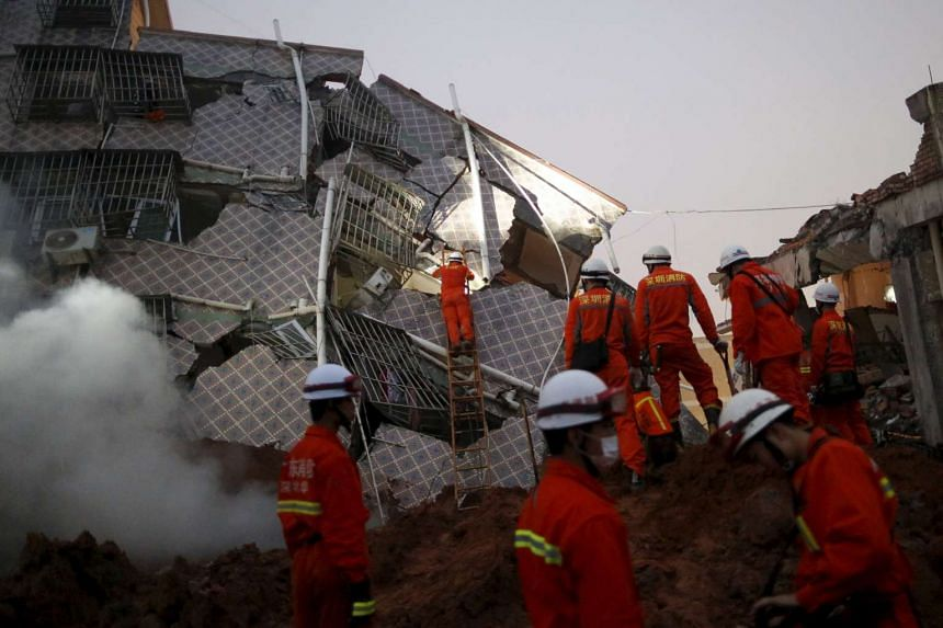 Firefighters searching for survivors among the debris of collapsed buildings after a landslide hit an industrial park in Shenzhen in China's Guangdong province on Dec 20, 2015.