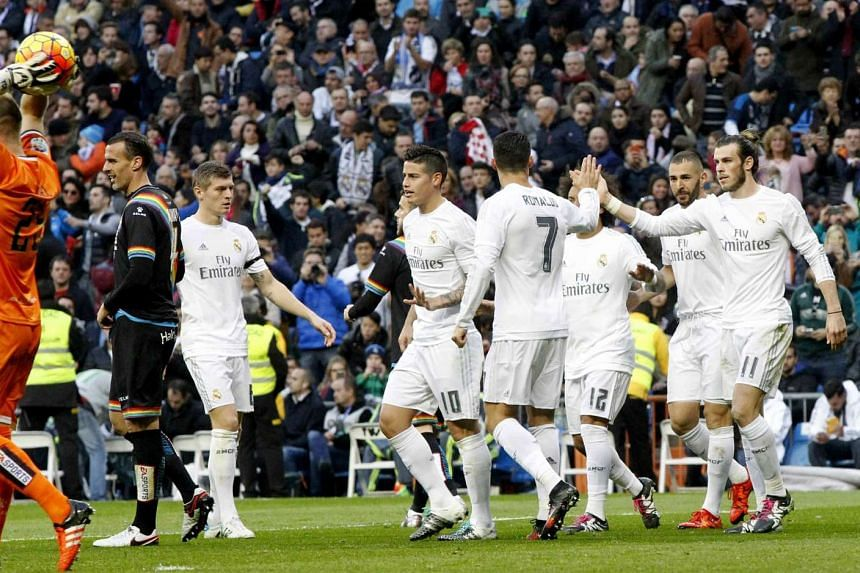 Real Madrid's players (from left to right) James Rodriguez, Cristiano Ronaldo, Gareth Bale and Karim Benzema celebrate their victory of 10-2 against against Rayo Vallecano during their Primera Division soccer match played at Santiago Bernabeu's stadi