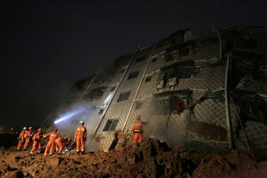 Rescuers work on the collapsed factory buildings brought down by a midday landslide in Shenzhen in south China's Guangdong province.