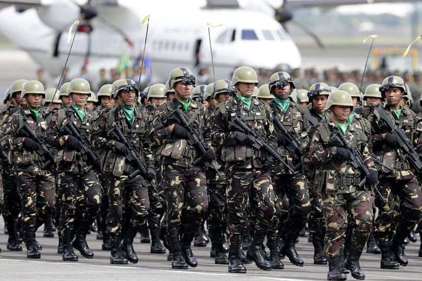 Filipino Army soldiers parading during the Armed Forces' 80th Anniversary celebration at Clark Air Base in Angeles City on Dec 21, 2015.