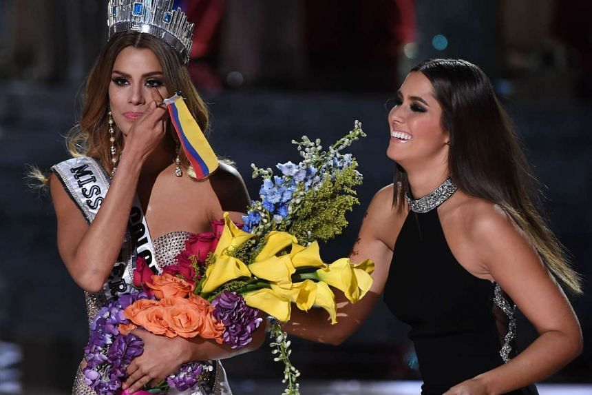 Miss Colombia 2015, Ariadna Gutierrez (left), is crowned the new Miss Universe by Miss Universe 2014 Paulina Vega after host Steve Harvey mistakenly named Gutierrez the winner instead of first runner-up during the 2015 Miss Universe Pageant at The Ax