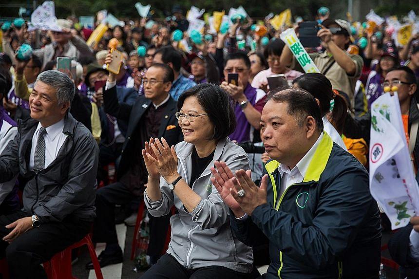 DPP chairman Tsai Ing-wen (above) at the rally yesterday.