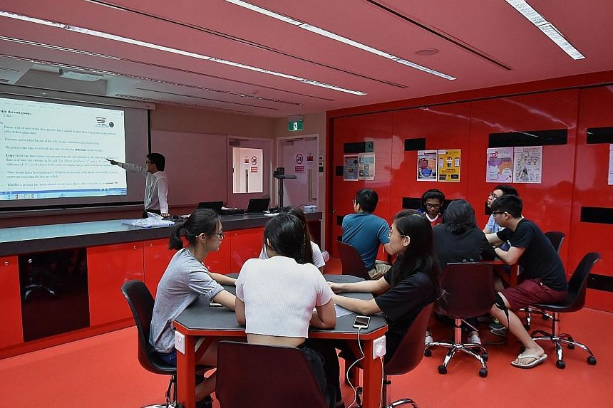 Singapore Polytechnic's Mr Patrick Phang uses pop quizzes and friendly competitions to engage students in the Polytechnic Foundation Programme (PFP). Normal (Academic) students in the year-long PFP skip the O levels and go straight to polytechnic.