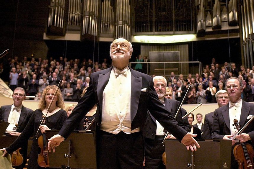The late Kurt Masur is seen in this 2010 photograph as the conductor of the London Philharmonic Orchestra at a concert in the Gewandhaus in Leipzig, Germany.