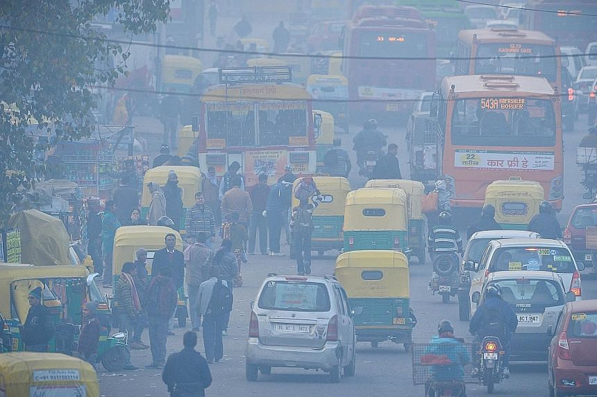 The air in the area around the bus terminus in Delhi's bustling Anand Vihar suburb, which is surrounded by major roads clogged with many old trucks and dust-generating construction activities, routinely tests far worse than the rest of Delhi.
