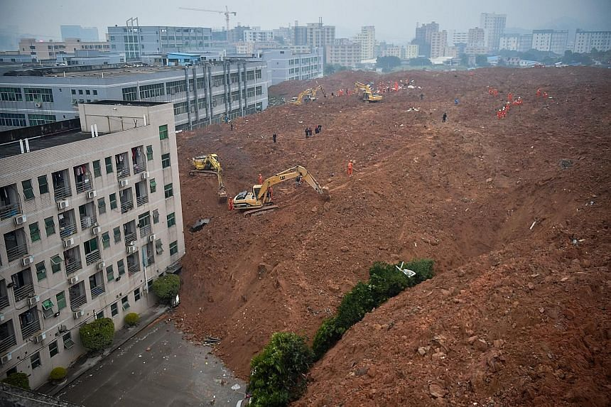 Two workers' dormitories were among the 22 buildings engulfed and toppled over yesterday morning by a rush of mud and earth at Liuxi Industrial Park in Guangming New District. Hundreds fled to safety as factories and buildings got buried under earth.