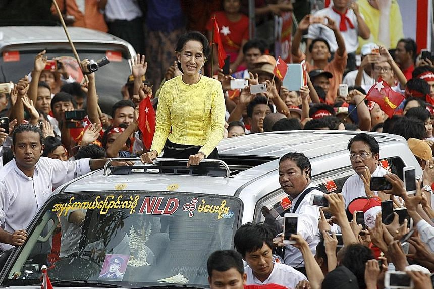 Myanmar pro-democracy leader Aung San Suu Kyi visiting her constituency in Kawhmu township, Yangon division, in October during a campaign rally. Her party swept to a stunning victory in the Nov 8 polls.