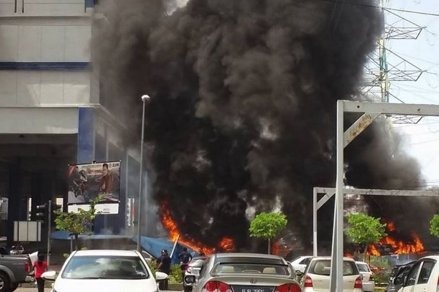 Plumes of smoke rising into the air after six cars caught fire near Taman Jaya LRT station on Dec 21, 2015.
