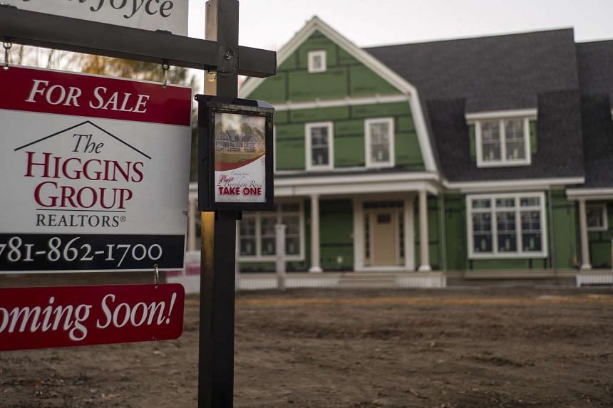 A sign sits outside a newly constructed home for sale in Lexington, Massachusetts, on Dec 16, 2015.
