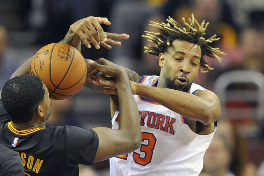 New York Knicks forward Derrick Williams (23) reaches for a rebound against Cleveland Cavaliers center Tristan Thompson (13) in the third quarter at Quicken Loans Arena.