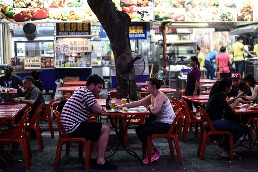 Foreign tourists and Malaysians visit the popular Jalan Alor food street in central Kuala Lumpur, Malaysia, Sep 25, 2015.
