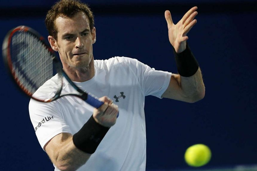 Britain's Andy Murray of  the Singapore Slammers hits a return to Australia's Bernard Tomic of Micromax Indian Aces on Dec16 in the United Emirate of Dubai.