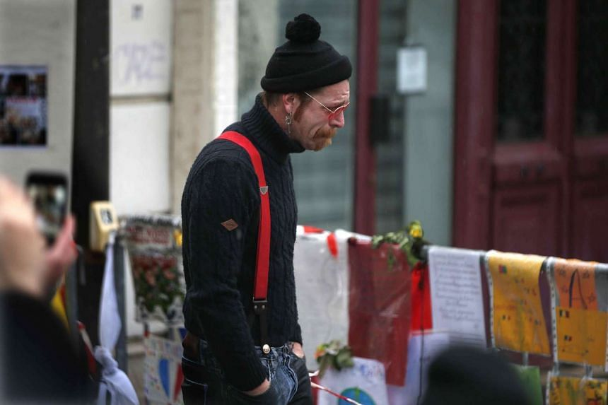 Eagles of Death member Jessie Huges mourns in front of the Bataclan concert hall  in Paris, France on Dec 8, 2015.