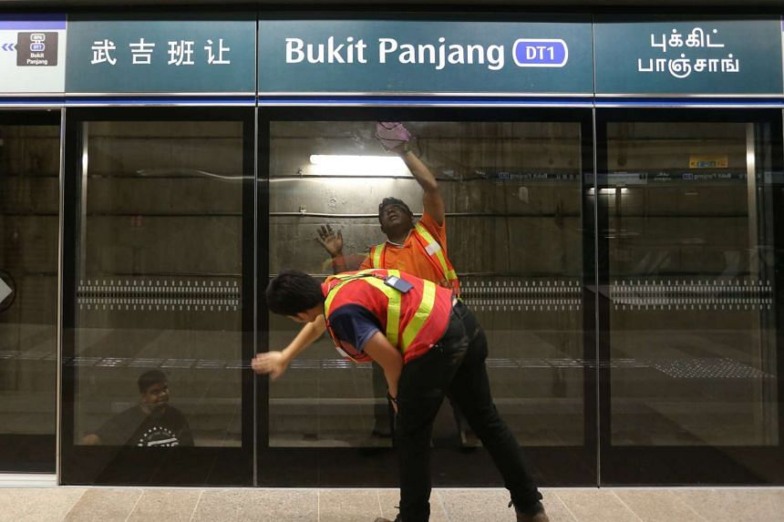 Workers cleaning the Bukit Panjang Downtown Line Station that will open officially on December 27.