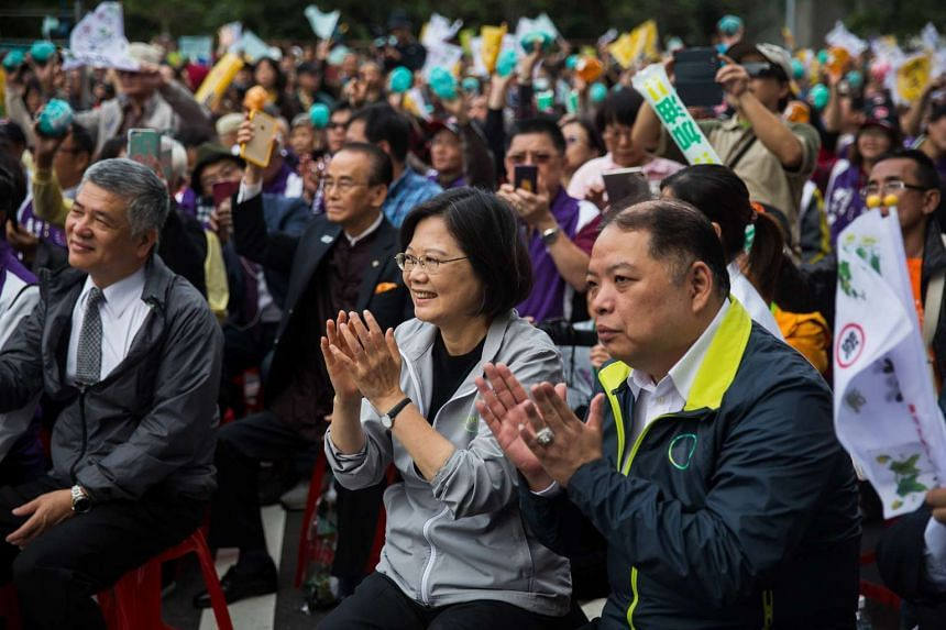 Ms Tsai Ing-wen (centre), presidential candidate and chairman of Taiwan's opposition DPP at a campaign event in Taipei on Dec 20, 2015.