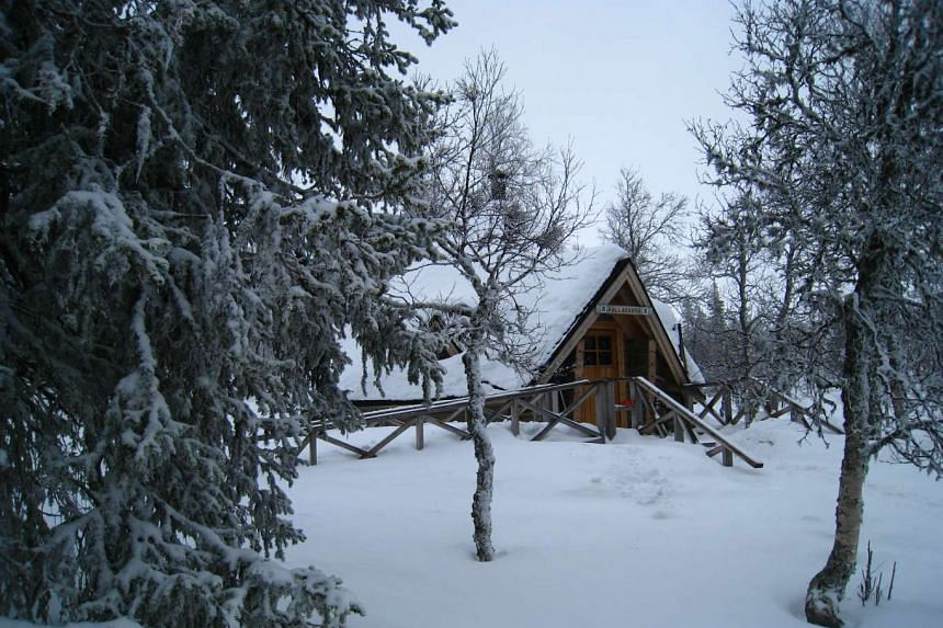 A view of a cottage mostly covered in snow in Pallas, located in Helsinski, Finland in November 2010.
