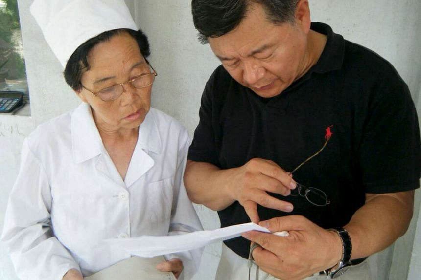 Canadian pastor Rev Hyeon Soo Lim (right) talking with a North Korean staff during a humanitarian assistance visits.