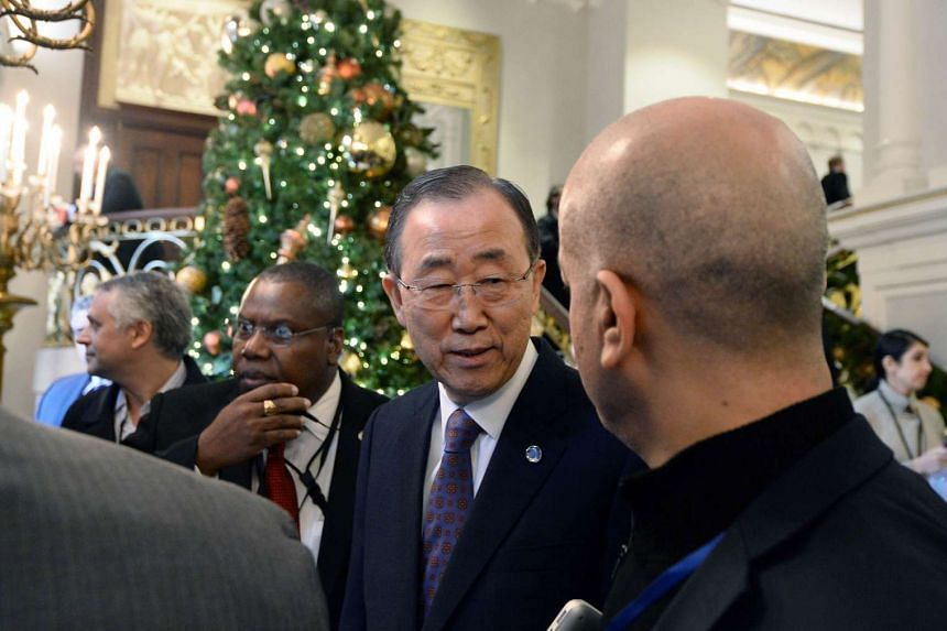 United Nations Scretary General Ban Ki-moon leaves a hotel following talks on Syria.