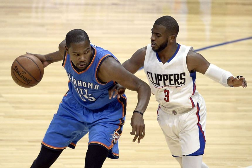 Oklahoma City Thunder Kevin Durant (left) works against Los Angeles Clippers Chris Paul in the first half of the game.