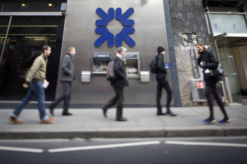 Pedestrians walk past a Royal Bank of Scotland Group Plc bank branch in London, UK, on Feb 19, 2014.