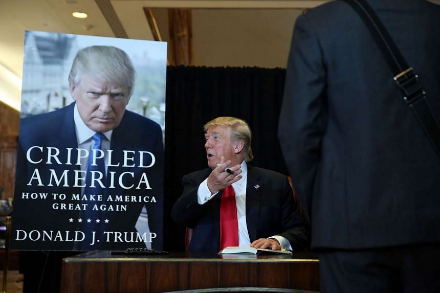 Donald Trump signs his book Crippled America: How to Make America Great Again in New York City.