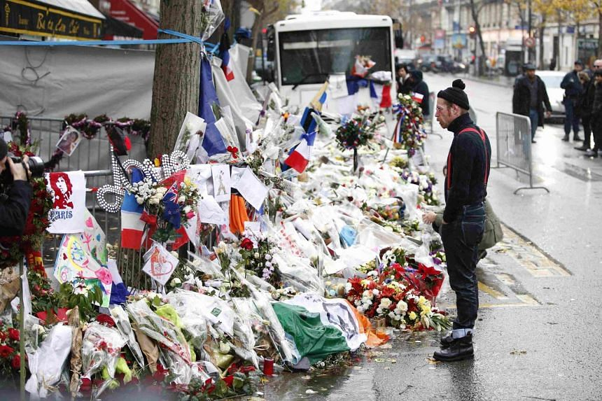 A member of Eagles of Death Metal band, Jesse Hughes, mourning in front of the Bataclan concert hall to pay tribute to the shooting victims in Paris, France, on Dec 8, 2015.