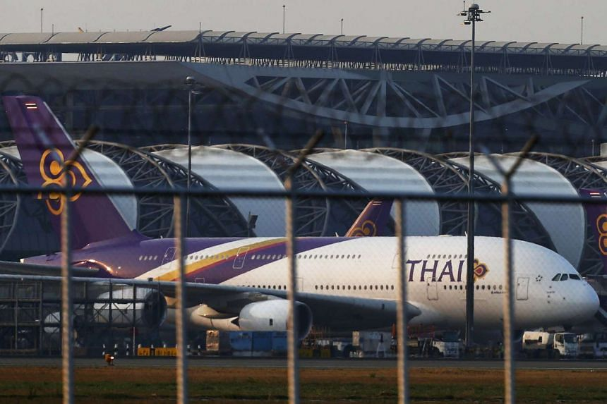 Thai Airways planes seen at Bangkok's Suvarnabhumi Airport in this Feb 26, 2014, file photo. Thai Airways International said it had passed an audit by the EASA allowing it to continue to fly to the EU.