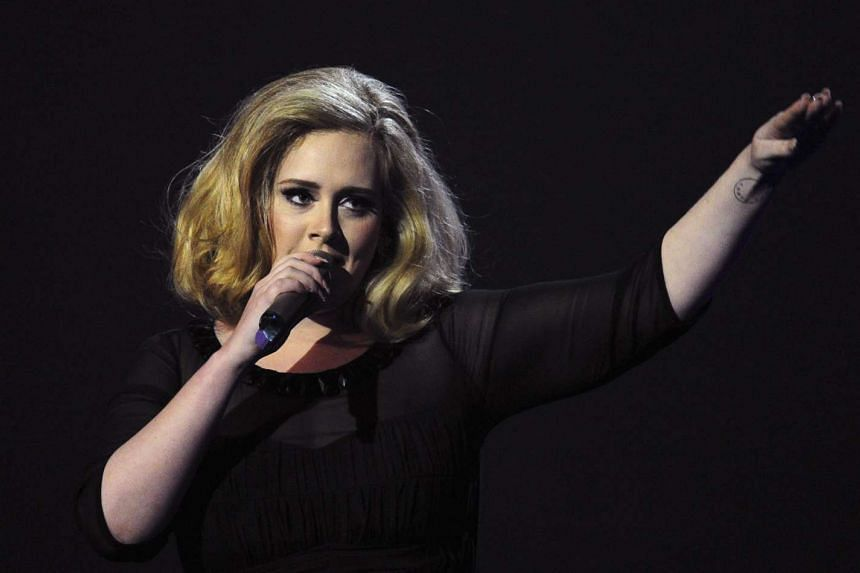 Adele accepting the British Female Solo Artist award at the BRIT Awards 2012 in London.