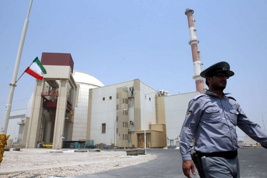 A file photo of an Iranian security officer walking in front of the nuclear power plant in Bushehr, southern Iran in 2010.