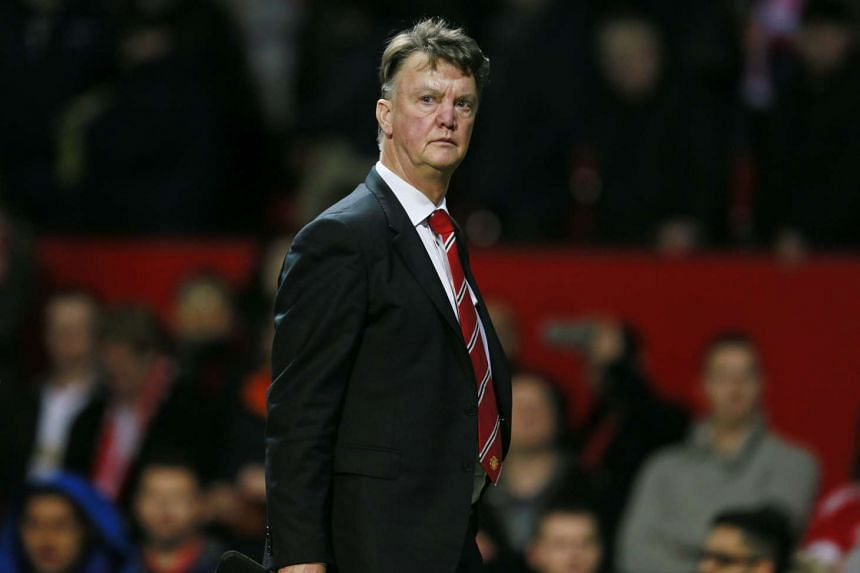 Manchester United manager Louis van Gaal walks off dejected after a game.