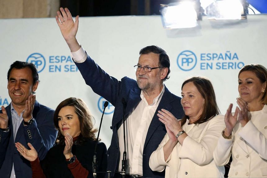 Spanish Prime Minister and candidate of the ruling Conservative Popular Party (PP), Mariano Rajoy (centre) and his wife Elvira Fernandez (2nd from right) celebrate with supporters their victory in the general elections in Madrid, Spain, on Dec 20, 20