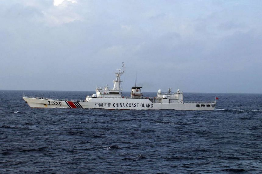A Chinese coast guard vessel is seen near the disputed Senkaku islands, or Diaoyu islands in Chinese, in a photo released by the Japan Coast Guard on Dec 22, 2015.