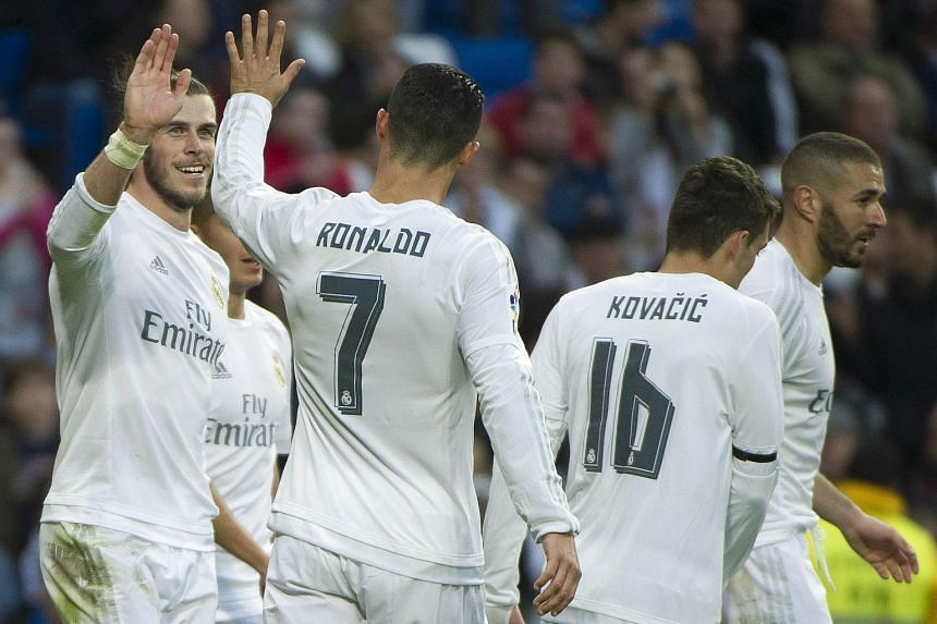 Gareth Bale (left) celebrating with Ronaldo and their Real Madrid team-mates after scoring against Rayo Vallecano. It is the first time the Welshman netted four times in a match in his three-year Madrid career.