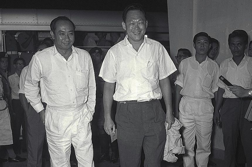 Dr Goh and Mr Lee awaiting results of the 1962 referendum on merger with Malaya at the Singapore Badminton Hall counting centre. On Dec 19, 1964, Tunku Abdul Rahman proposed to Mr Lee possible constitutional rearrangements.