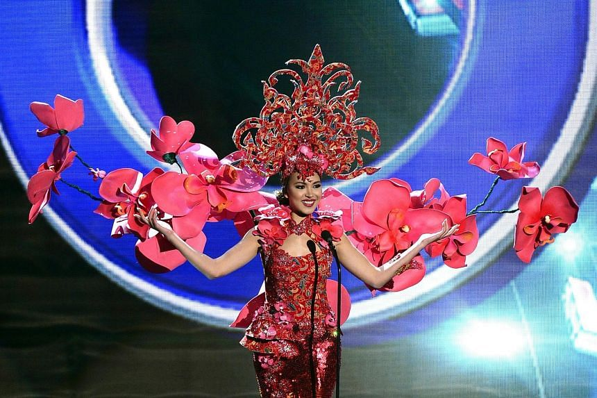 Singapore's Ms Lisa Marie White on stage in her national costume at the Miss Universe pageant in Las Vegas. Ms Pia Alonzo Wurtzbach of the Philippines being crowned Miss Universe by last year's winner Paulina Vega. Ms Ariadna Gutierrez (left) of Colo
